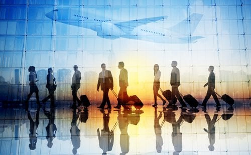 Group of Business Travellers Walking in an Airport