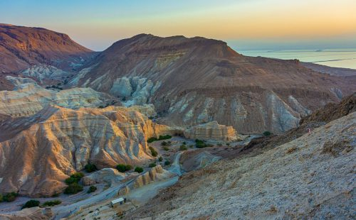 The colorful desert sand of Judean Mountains overlooking the Dead Sea at the south of Israel