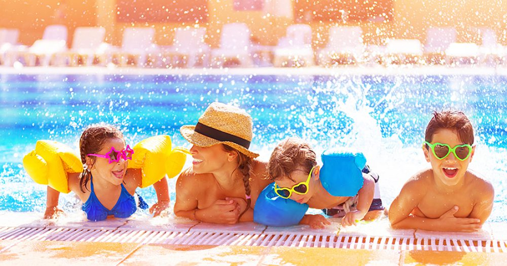 21871473 - active happy family having fun in the pool, spending time together in aquapark, summer holidays, joy and pleasure concept